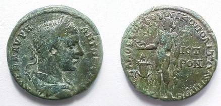 Ancient Coins - Elagabalus AE28 of Nikopolis ad Istrum.  Apollo, naked, standing left sacrificing from patera over flaming altar to left & holding branch.
