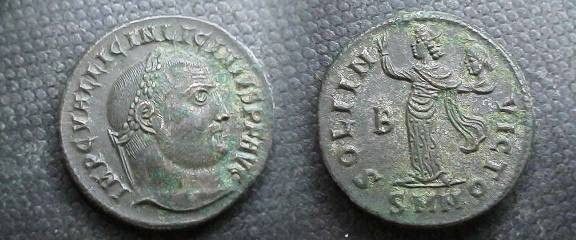 Ancient Coins - Licinius AE20 Follis.  SOLI INVICTO, Sol, radiate, standing left in long robe with raised right hand and head of Serapis in left.