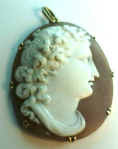 World Coins -  Large 18th (?) century cameo of a curly haired beautiful woman  in a 14 k gold bezel. Please make your best offer!