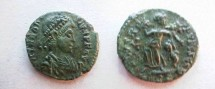 Ancient Coins - Theodosius I AE4.  SALVS REIPVBLICAE, Victory advancing left, carrying trophy and dragging captive.