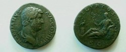Ancient Coins - HADRIAN Æ Sestertius.  AEGYPTOS, Egypt reclining left & holding sistrum, left elbow resting on basket of grain, ibis on column at feet.