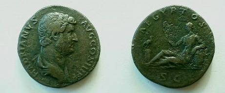 Ancient Coins - HADRIAN Æ Sestertius.  AEGYPTOS, Egypt reclining left & holding sistrum, left elbow resting on basket of grain, ibis on column at feet.