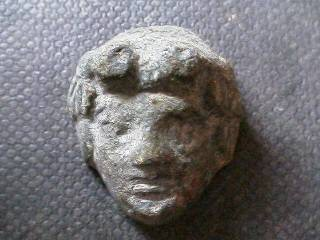 Ancient Coins -  Roman bronze applique of a head, possibly Dionysos.  26mm.