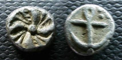 Ancient Coins - Thrace Apollonia Pontika.c. 450-400 AR Tritartemorion or ¾ obol (Silver, 0.5 g)( 0.5 mm), Av.: Anker. Rv.: Swastika.