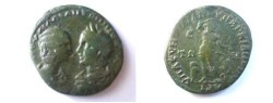 Ancient Coins - Julia Domna & Caracalla AE29 of Markianoplis.  Apollo standing right holding bow, altar behind, snake climbing tree before, E in left field.