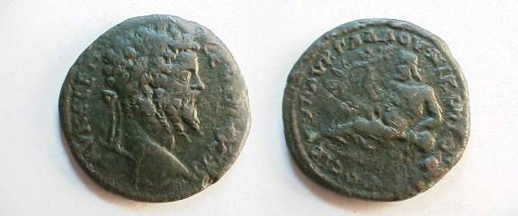 Ancient Coins - Septimius Severus AE28 of Nikopolis ad Istrum. River god, holding cornucopiae, reclining left on jug from which river waters flow.
