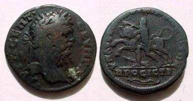 Ancient Coins - Septimius Severus AE28 of Nikopolis ad Istrum.  Hercules subduing the Cretan Bull left, bow in ex.