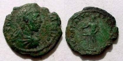 Ancient Coins - Elagabalis AE18 of Nikopolis. Priapus standing left with enormous penis.