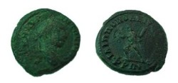 Ancient Coins - Caracalla AE21 of Philippopolis, Thrace.  Nude male figure advancing left with wreath and palm branch.