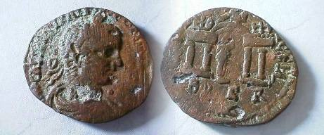 Ancient Coins - Elagabalus AE27 of Berytos, Phoenicia.  COL IVL AVG FEL BER, arched gateway with two columns to either side, statue of Marsyas standing on base.