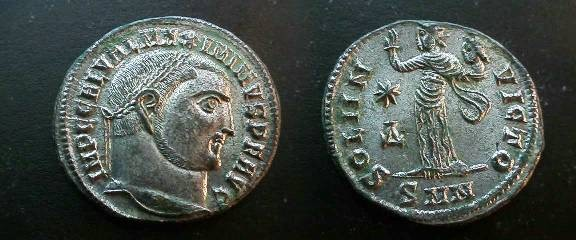 Ancient Coins - Maximinus II Silvered Æ Follis.  SOLI INVICTO, Sol standing left in long robe, with raised right hand & holding up head of Serapis in left, *A to left, SMN in ex. EF!