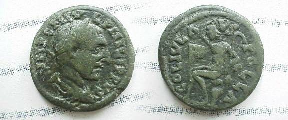 Ancient Coins - Philip I AE25 of Pella, Macedonia.  COL IVL AVG PELLA, Pan seated left on rock, holding lagobalon (throwing stick), his flute (