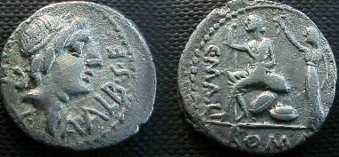 Ancient Coins - L Caecilius Metellus,  96 BC.  C•MALL, ROMA in exergue, Roma seated left on pile of arms, being crowned by Victory.
