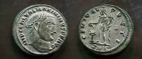 Ancient Coins - Maximinus II AE Follis.  GENIO AVGVSTI, Genius standing left sacrificing over lit altar from patera, holding cornucopiae, B to right, SMK in ex.