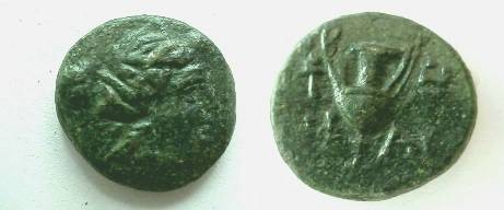Ancient Coins -  AE18 from Dionysos?.Female head right / kantheros, torch to left.  EF with beautiful green patina.RARE