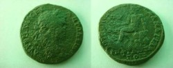 Ancient Coins - Caracalla AE31 of Philippopolis, Thrace.  Hermes (or Hemos, Old Mountain?) seated left on rock.