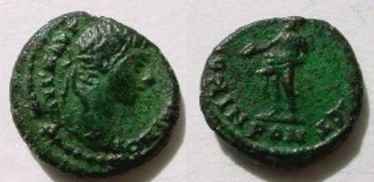 Ancient Coins - Caracalla AE18 of Nikopolis ad Istrum.Priapus standing left with enormous penis.  Rare.