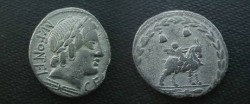 Ancient Coins - M.  Infant winged Genius seated on a goat right.