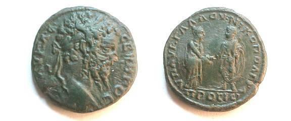 Ancient Coins - Septimius Severus AE28 of Nikopolis ad Istrum.  Concordia (?) clasping hands with the emperor.