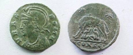 Ancient Coins - Urbs Roma Commemorative AE3.  She-wolf standing left suckling Romulus and Remus, two stars above, .