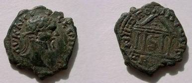 Ancient Coins - Septimius Severus AE18 of Nikopolis ad Istrum. Tetrastyle temple with peaked root, Asklepios~ staff within.