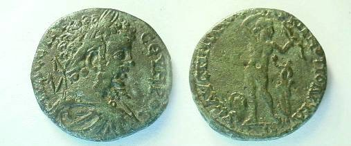 Ancient Coins - Septimius Severus AE27 of Marcianopolis.  Apollo standing right, arm over head, holding bow, serpent entwined around a tree stump before, altar behind.