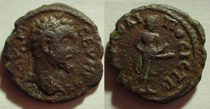 Ancient Coins - Septimius Severus AE19 of Nikopolis. AV K LI CEVHPOC, laureate head right /, Priapus standing right exposing his penis.
