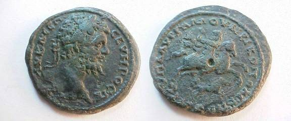 Ancient Coins - Septimius Severus AE29 of Nikopolis ad Istrum.  The emperor galloping on horseback right, spearing a wild boar below.