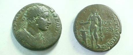 Ancient Coins - Elagabalus AE26 of Nikopolis ad Istrum. Apollo standing left, sacrificing from patera over lit altar to left, holding branch.