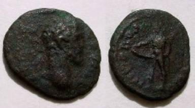 Ancient Coins - Septimius Severus Æ17 of Nikopolis. Ithyphallic Priapus standing left.