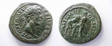 Ancient Coins - Commodus AE20 of Markianopolis.  Hercules wrestling Namean lion left.