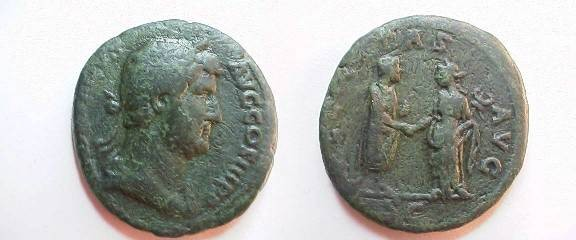 Ancient Coins - Hadrian Æ As.  FELICITAS AVG S-C, Hadrian,with scroll, clasping hands with Felicitas, with caduceus.