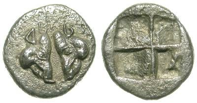 Ancient Coins - AMAZING GREEK SILVER FRACTION. TWO BOAR HEADS COMFRONTED. SUCH AN INTERESTING MINIATURIZED COIN !