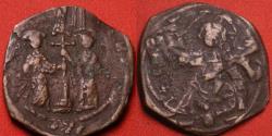 Ancient Coins - CONSTANTINE X COMNENUS & EUDOCIA AE follis. Christ standing. Overstruck on earlier anonymous follis.