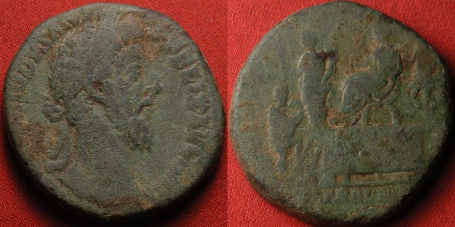Ancient Coins - COMMODUS AE sestertius. 7th donative, Rome, 186 AD. LIB AVG VII, Donation scene, Commodus on platform with Liberalitas, dispensing largesse. Scarce