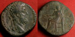 Ancient Coins - COMMODUS AE sestertius. Rome, 189 AD. Pax seated, holding branch & scepter. Lovely portrait