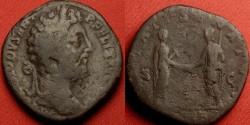 Ancient Coins - COMMODUS AE sestertius. Rome, 189 AD. PIETATI SENATVS, Commodus clasping hands with Genius of the Senate.