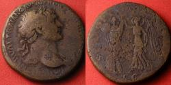 Ancient Coins - TRAJAN AE orichalcum sestertius. SPQR OPTIMO PRINCIPI, Victoria holding palm & erecting trophy of arms.