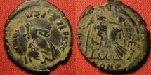 Ancient Coins - Late 4th century bronze overstrike - Arcadius/Honorius/Valentinian II. Emperor crowned by Victory, Roma seated. Two obverse portraits. Interesting