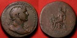 Ancient Coins - TRAJAN AE orichalcum sestertius. PROVINCIA DACIA AVGVST, Dacia seated atop pile of rocks, children at her side.