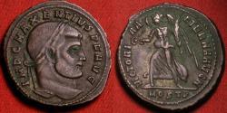 Ancient Coins - MAXENTIUS AE silvered follis. Ostia mint. VICTORIA AETERNA AVG N, Victory holding wreath.