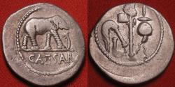 Ancient Coins - JULIUS CAESAR AR silver denarius. Elephant trampling serpent. Four priestly implements.