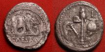 Ancient Coins - JULIUS CAESAR AR silver denarius. Elephant trampling serpent. Four priestly implements.