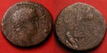 Ancient Coins - TITUS AE 26mm. Judaea Capta issue. CAESAREA MARITIMA, JUDAEA. Trophy of arms, captive Judaea beneath, shield beside.