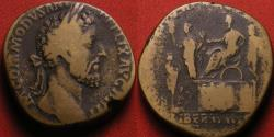 Ancient Coins - COMMODUS AE sestertius. 7th donative, Rome, 186 AD. Platform scene, Commodus standing, with two attendants, dispensing largess to citizen. Scarce.