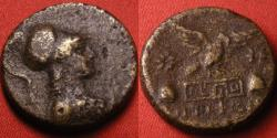 Ancient Coins - APAMEIA, Phrygia, AE 23mm. Bust of Athena in Corinthian helmet, Eagle standing on base, caps of the Dioskouroi beside.