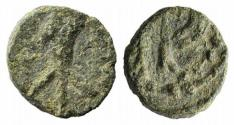 Ancient Coins - Visigoths in Spain, c. 6th century. Æ Nummus. Emerita. Stylized bust facing (?). R/ Monogram. VERY RARE