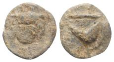Ancient Coins - Roman PB Tessera, c. 1st century BC - 1st century AD. Facing head (Medusa?). R/ Crescent or mussel