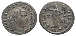 Ancient Coins - Maximinus II (310-313). Æ Follis. Antioch, AD 312.  R/ Sol standing facing, head l., holding bust of Serapis and raising hand