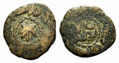 World Coins - Islamic, al-Andalus (Spain), Umayyad Caliphate. Anonymous issue, AH 92-138 / AD 710-756. Æ 20mm. Arab legend. R/ Central star within Arab legend.